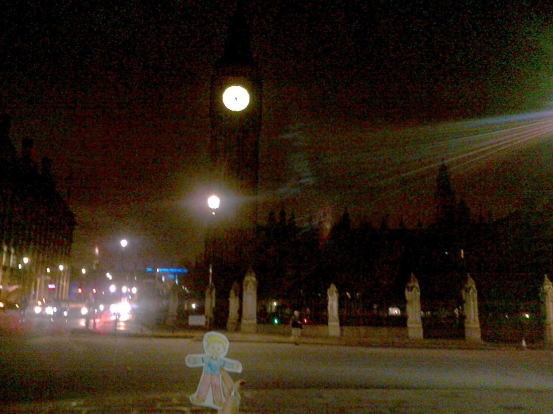 Flat Stanley, a book character cut out, visiting Big Ben