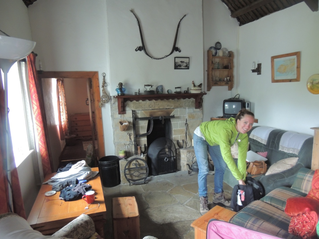 Inside the cottage. Note the old time fire tools.
