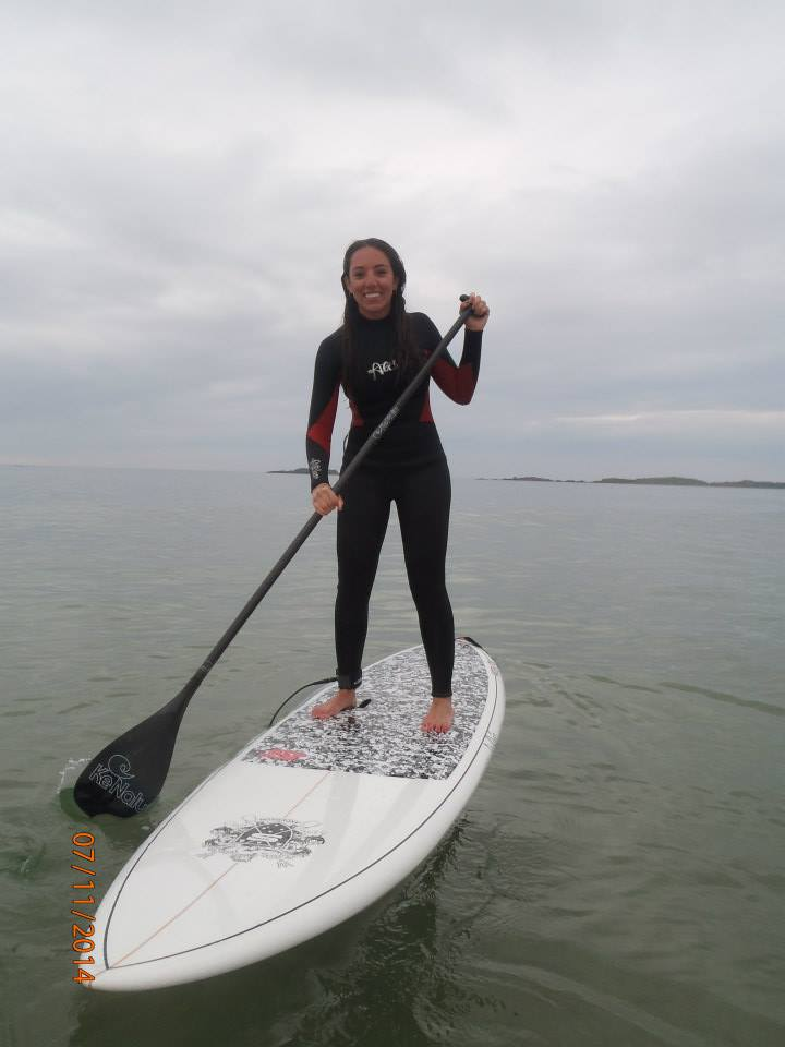 Kacey, skillfully balancing on a SUP. Skills: Map-reading. Memorable quotes: A Forrest Gump retelling of Fungi the Dingle dolphin story.