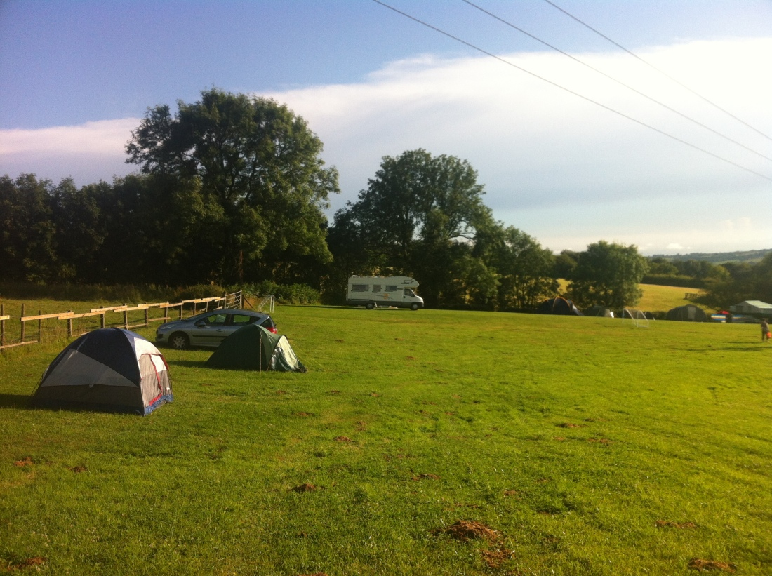 A sunny glimpse at the farm, with our tent in the foreground