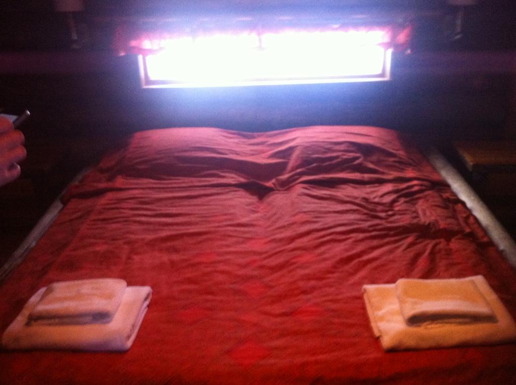 Bed and midnight sun-orange duvet