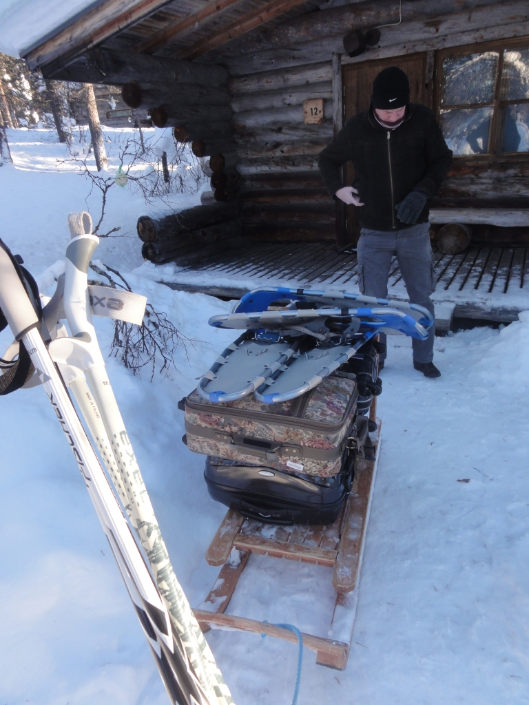 Loading our things into the sled.