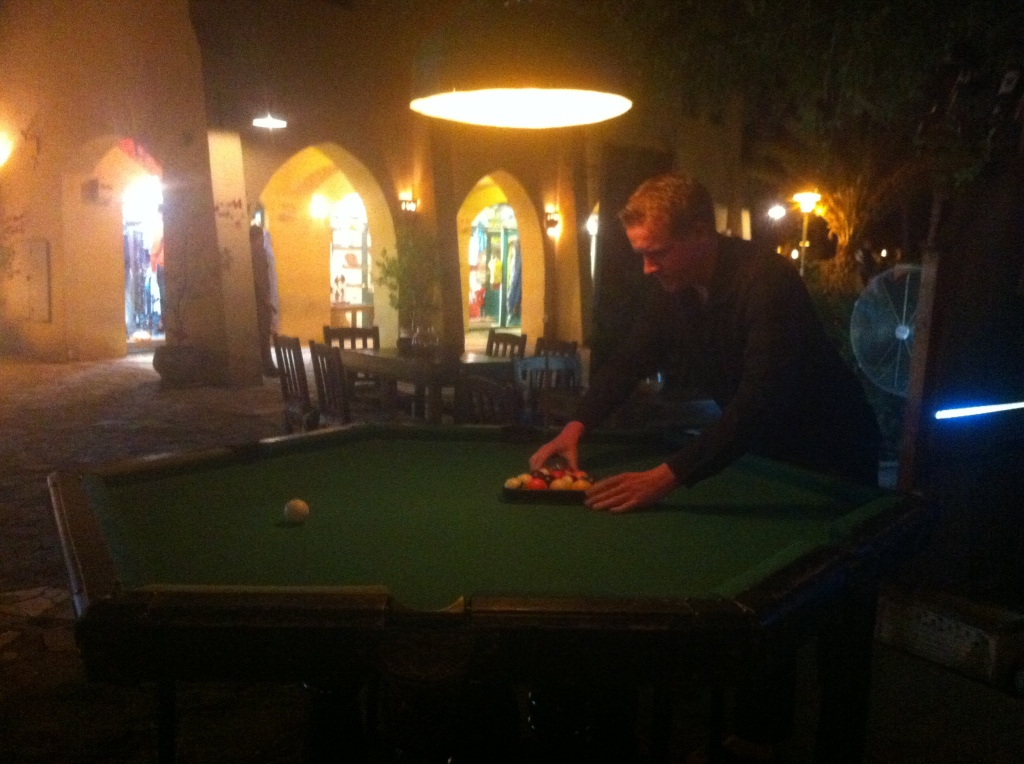 Jamie, expertly racking the balls on this bizarre pool table