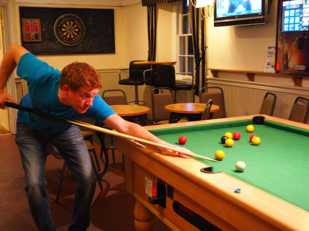 Jamie does his best at pool