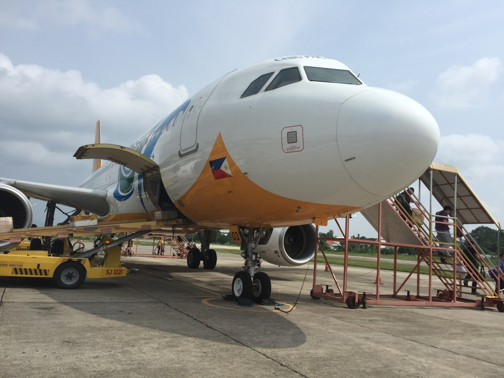 A Cebu Pacific flight on the tiny runway